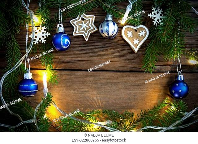 Fairy Lights and Christmas Decoration as Background on Wood