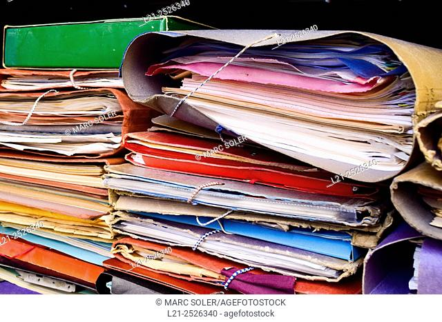 Stacks of old folders with documents inside