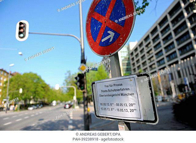 A no stopping sign and a sign for the press parking spots stand in front of the criminal justice building in Munich, Germany, 05 May 2013