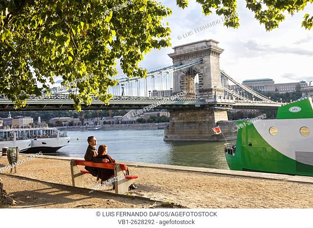 People at the Danube promenade by the Chain Bridge. Budapest, Hungary