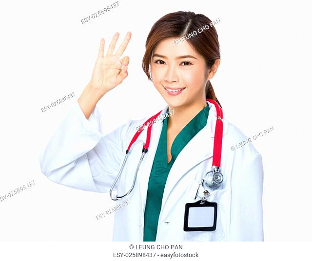 Female doctor with ok sign gesture