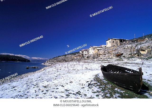 Psarades village, houses, boat on the shore , Lake of Prespes, Macedonia Central, Greece