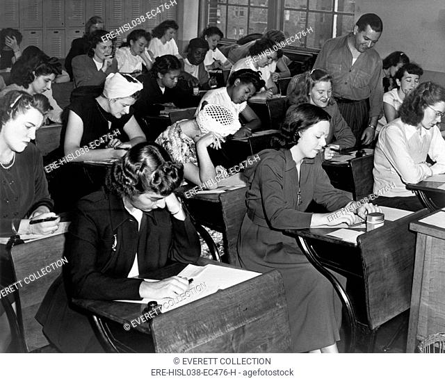 Women taking the qualifying exam for the New York City police force. 1947. (BSLOC-2014-13-218)