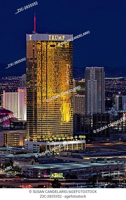 Trump International Hotel Las Vegas - Aerial view of the Trump Hotel with a warm glow from the setting sun against the blue sky during twilight