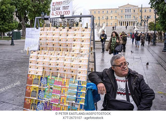 Selling lottery tickets in front of the parliament building in Syndagma Square, cental Athens, Greece