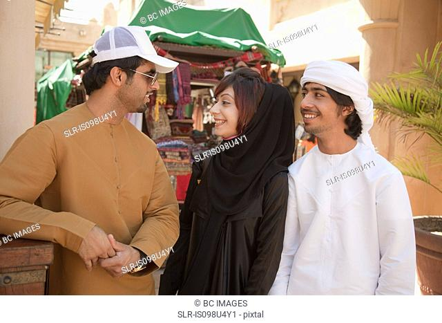 Middle Eastern people talking together