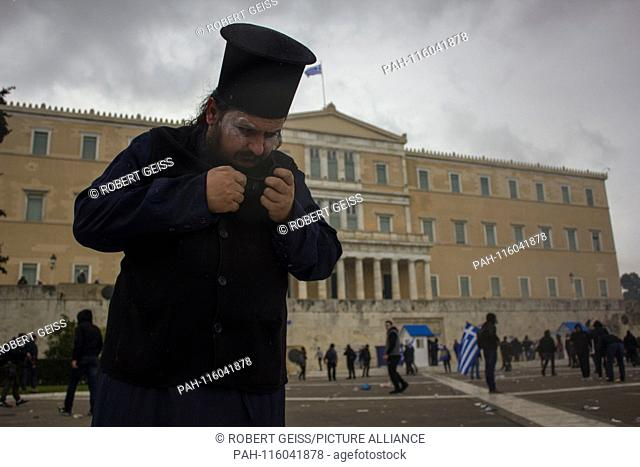Greek Orthodox priest after tear gas in front of Parliament, during protest against recognition FYROM as North Macedonia. 20.01.2019 | usage worldwide
