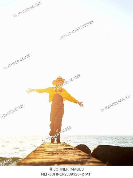 Girl on jetty