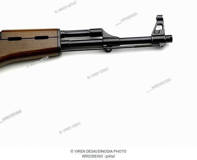 Barrel of AK-47 gun on white background