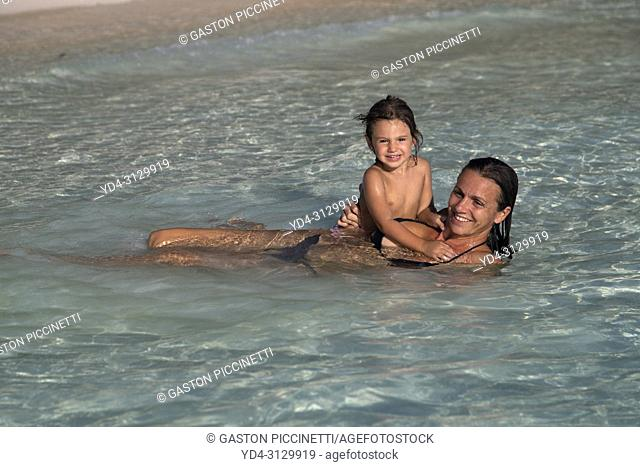 Mother and daughter on the beach, Gauldin Cay Beach, North Eleuthera Island, Bahamas