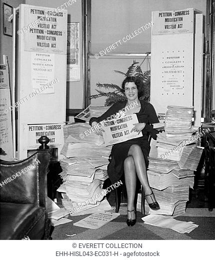 Woman holding a 'Petition to Congress/ Modification, Volstead Act.' It would allow the brewing of 2.75% beer. In 1932, public opinion had turned against...