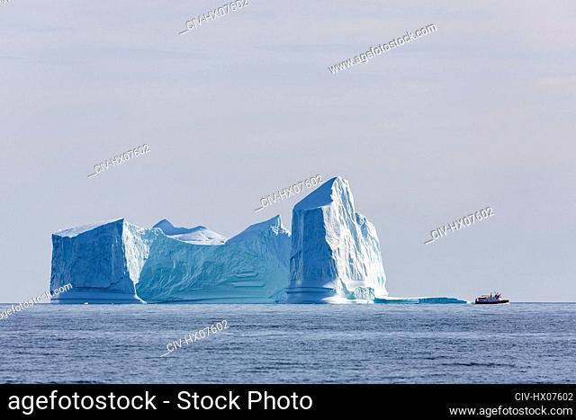 Majestic iceberg formations on sunny blue Atlantic Ocean Greenland