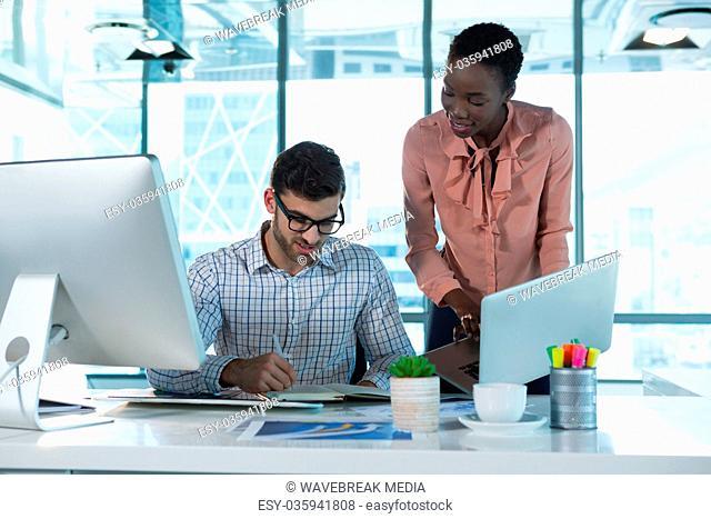 Executives working together at desk