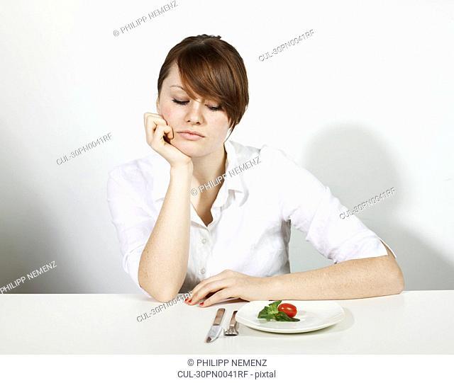 Women with Salad looking sad
