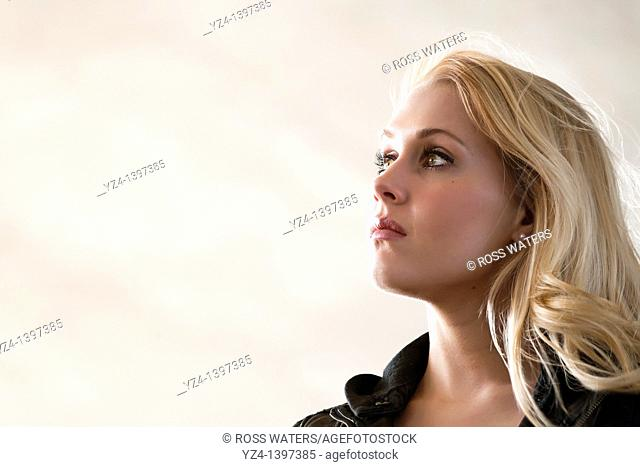 Profile of a young woman outdoors