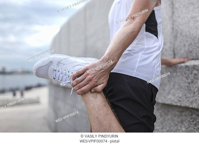 Close-up of athlete stretching outdoors