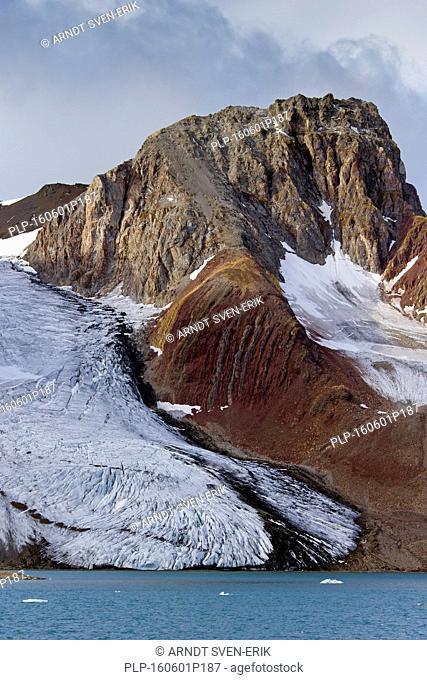 Samarinbreen glacier debouches into Samarinvågen, bay of the fjord Hornsund in Sørkapp Land at Spitsbergen, Svalbard