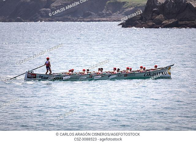 CASTRO URDIALES, SPAIN - JULY 15, 2018: Competition of boats, regata of trainera, Ondarroa Cikautxo boat in action in the VI Bandera CaixaBank competition