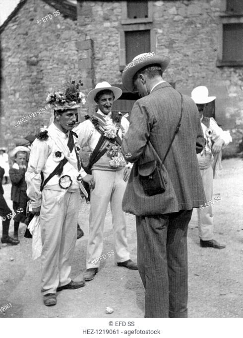 Cecil Sharp with Winster Morris Dancers, Derbyshire, 1908. Photograph taken during one of British musicologist Cecil Sharp's (1859-1924) expeditions to collect...