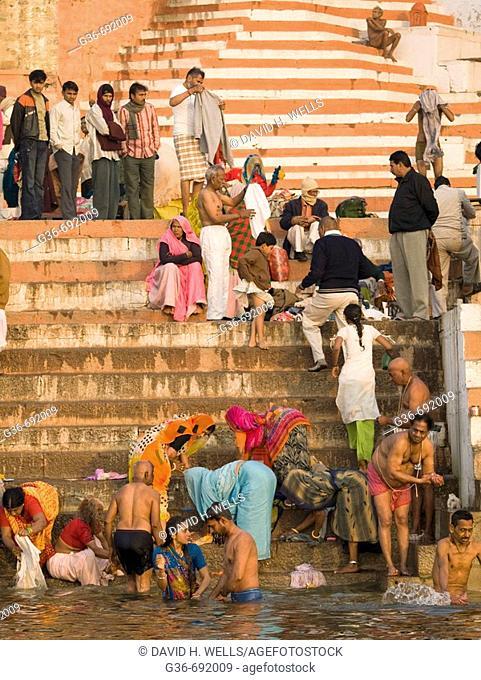 Pilgrims bathe in the holy river Ganges, an important pilgrimge site for Hindu's, in Varanasi, Uttar Pradesh, India