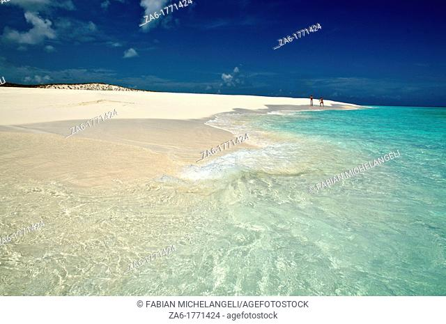 People walking in a desolate and pristine white sand beach  Cayo de Agua, Los Roques National Park, Venezuela
