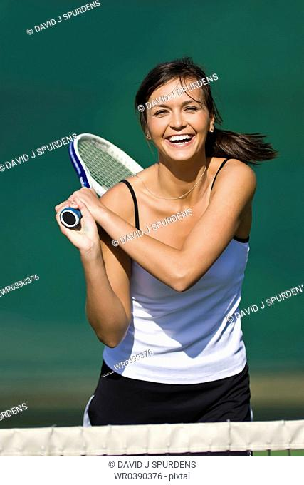 Happy tennis player having fun and smiling