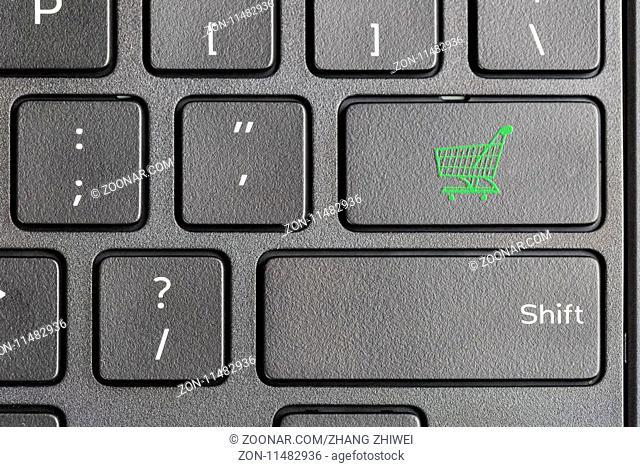 green shopping cart key on computer keyboard , online shopping concept