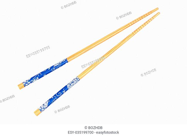 Pair of wood chopsticks isolated on the white background