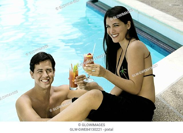 High angle view of a young couple holding drinks