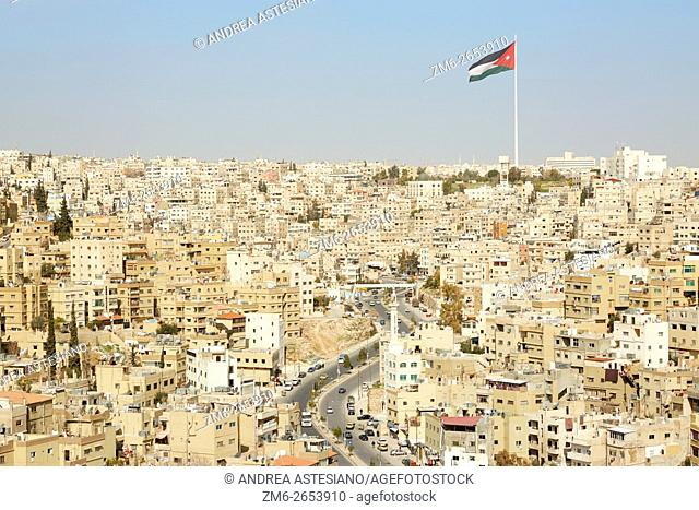Amman city view with big Jordan flag and flagpole