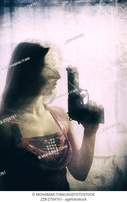 Woman holding a handgun