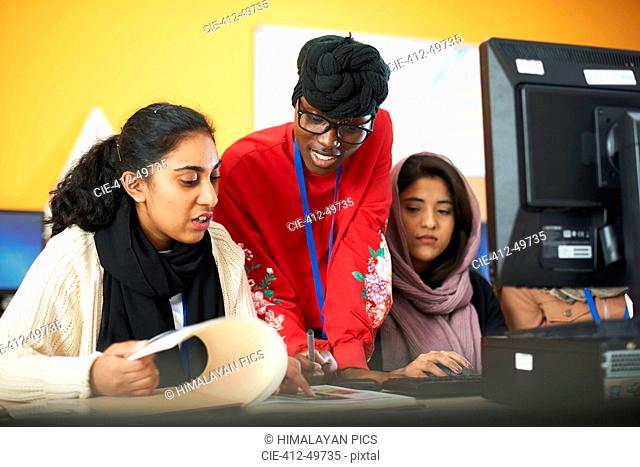 Female multi-ethnic college students using computer in computer lab