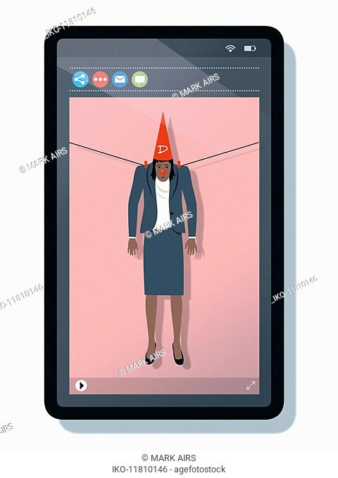 Woman hung out to dry with dunce's hat on mobile phone screen