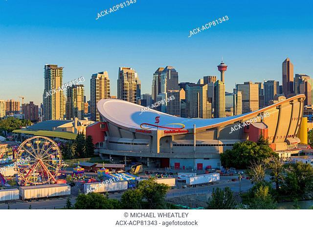 The Stampede Midway, Saddledome and Calgary skyline, Calgary, Alberta, Canada