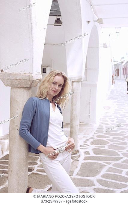 Woman posing in Paros, Cyclades Islands, Greece