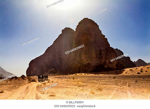 Seven Pillars of Wisdom Rock Formation Jeeps Wadi Rum Valley of the Moon Jordan. Inhabited by humans since prehistoric times