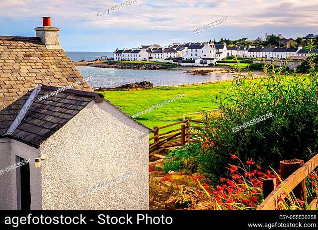 Landscape view of Port Charlotte houses on an ocean coastline, Isle of Islay, Scotland, United Kingdom