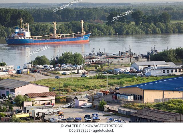 Romania, Danube River Delta, Tulcea, elevated view of freighter on the Danube River, dawn