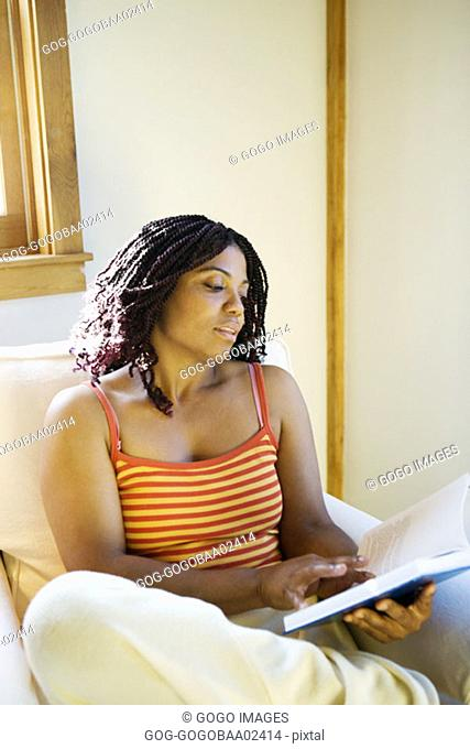 Young African woman reading