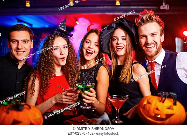 Young people cheering at Halloween night