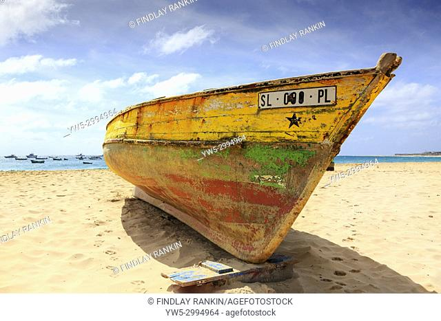 Local traditional wooden fishing boat on the beach at Santa Maria, Sal Island, Salinas, Cape Verde, Africa,