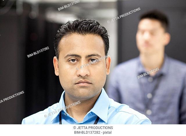 Businessmen standing in server room
