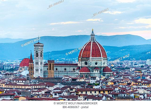 Panoramic view of the city with Florence Cathedral, Duomo Santa Maria del Fiore with the dome by Brunelleschi, UNESCO World Heritage Site, dusk, Florence