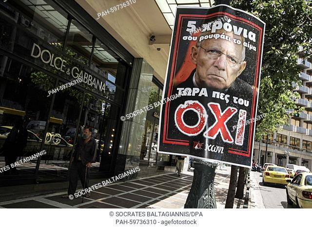 """Poster picturing Germany's Federal Minister of Finance Wolfgang Schäuble that reads """"""""5 years he sucks your blood - Now say NO to him"""""""" in Athens"""