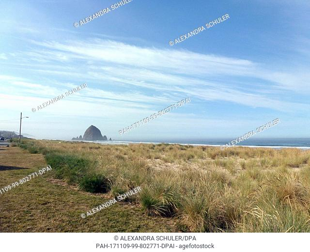 View of the Haystack Rock at the Southern end of Cannon Beach, US, 3 September 2017. The Haystack Rock is a 72-meter-high monolith at the coast of Oregon in the...