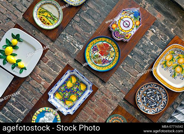 colourful decorated ceramic plates in Siena Tuscany