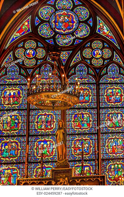 Mary Statues Candles Stained Glass Notre Dame Cathedral Paris France. Notre Dame was built between 1163 and 1250 AD