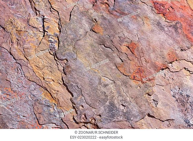 Rough surface of a colored stone slab