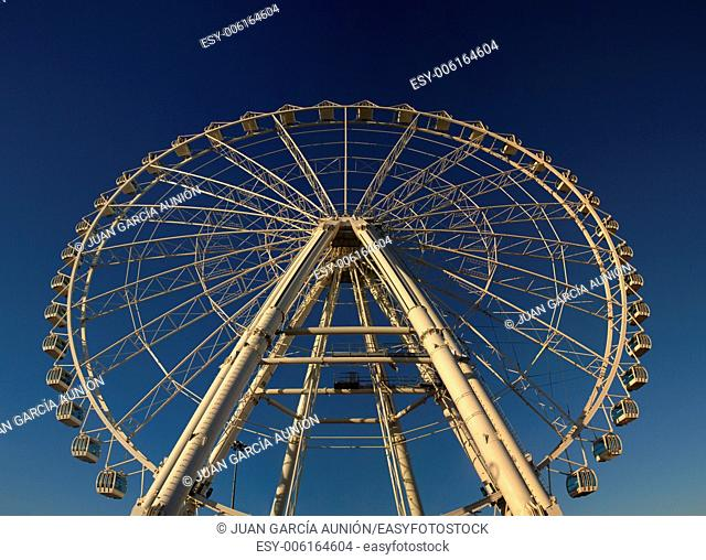Ferris wheel on blue sky, at the fair in Cordoba