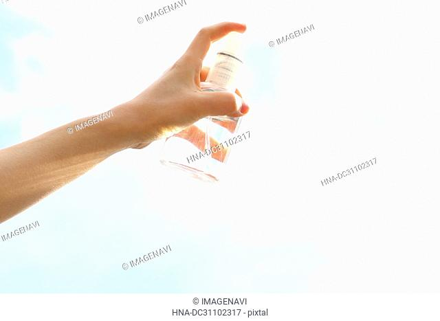 Woman Hand Holding Spray
